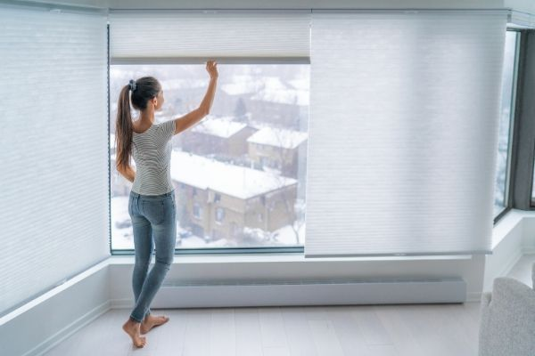 Woman selects the right window coverings can make your home more comfortable